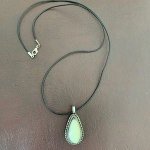 Necklace with white color stone on black cord